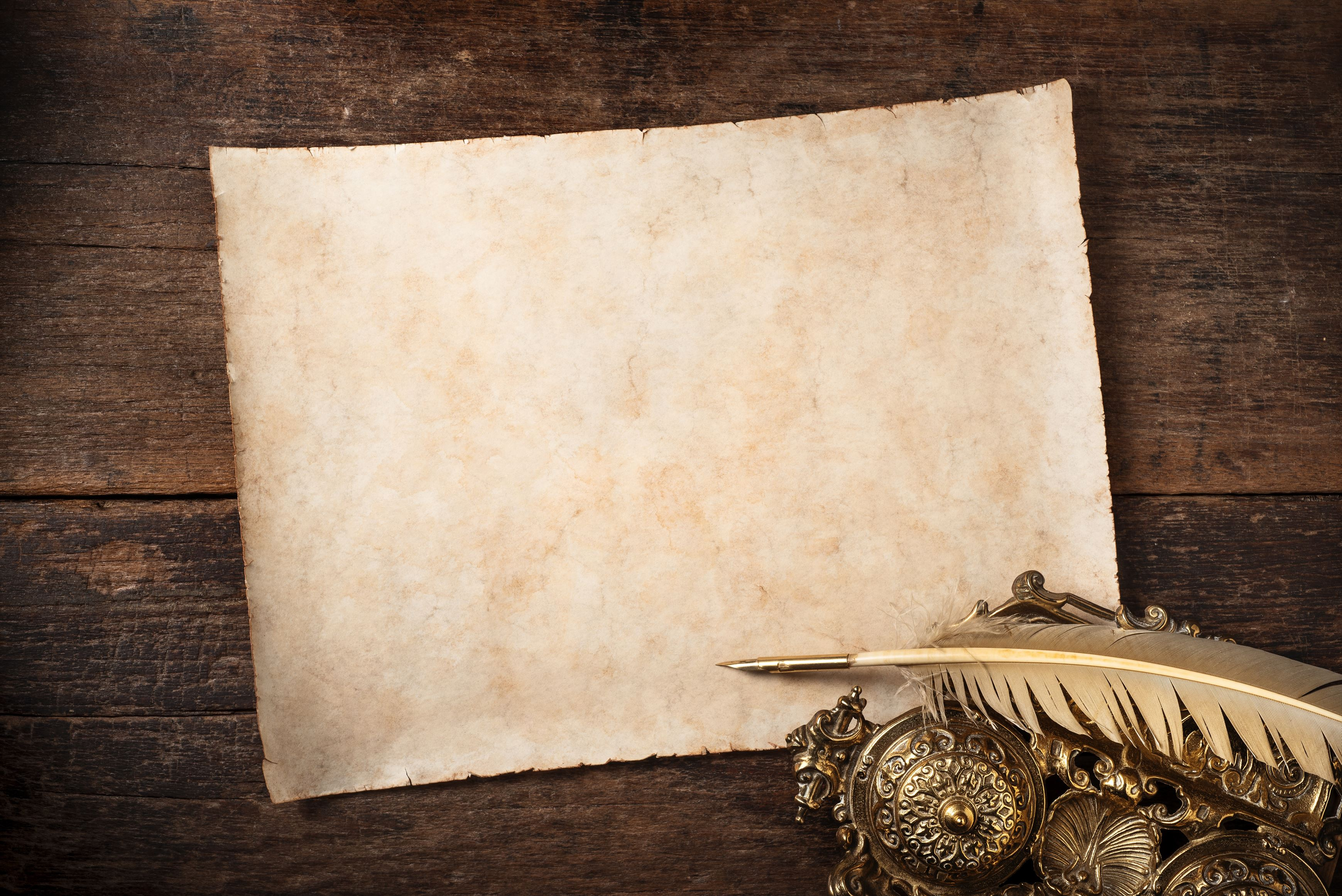 parchment on old writer desk,vintage background