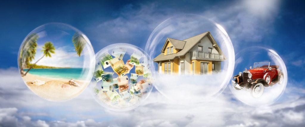 Seifenblasen mit Strandszene, Geldscheinen, Haus und Auto